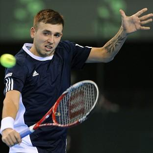 Dan Evans was beaten in straight sets in Melbourne