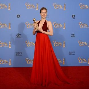 Salisbury Journal: Amy Adams with the award for best actress in a motion picture - comedy or musical
