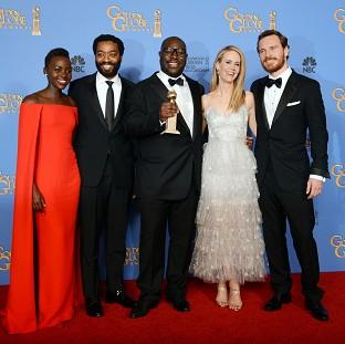 Salisbury Journal: From left, Lupita Nyong'o, Chiwetel Ejiofor, Steve McQueen, Sarah Paulson and Michael Fassbender with the award for best motion picture - drama (AP)
