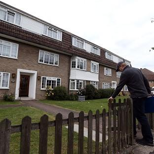 Salisbury Journal: Police at flats in Bray Court in Chessington, Surrey where they arrested the brother of murdered British engineer Saad al-Hilli. Zaid al-Hilli has been released from police bail due to lack of evidence.