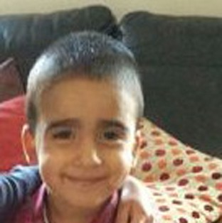 Woman is charged over Mikaeel death