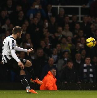 Yohan Cabaye, left, curls in his second of the game to secure victory for Newcastle