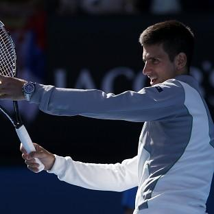 Novak Djokovic, pictured, routed Fabio Fognini to reach the Australian Open quarter-finals (AP)