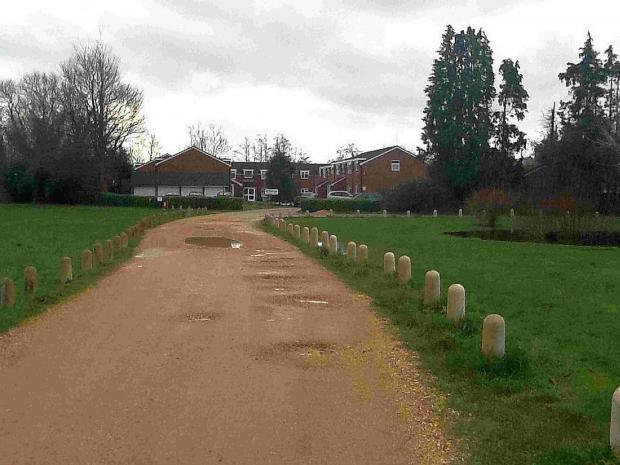 The gravel track maintained by the residents of Old Mill House