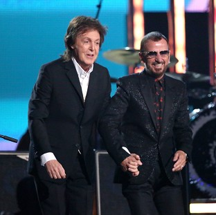 Sir Paul McCartney, left, and Ringo Starr perform together at the Grammys (AP)