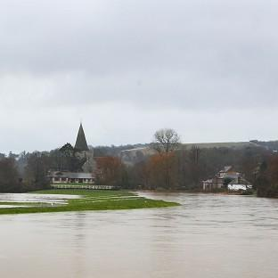 Salisbury Journal: The swollen Cuckmere River heads towards Alfriston, East Sussex, as more heavy rain sweeps across the country