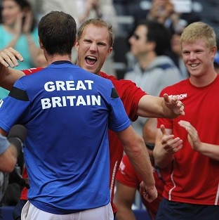 (Left to right) Andy Murray, Dominic Inglot and Kyle Edmund celebrate Britain's Davis Cup win over the US (AP)