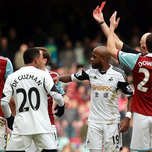 West Ham's Andy Carroll (left) will be banned for three matches