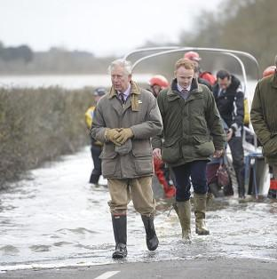 Salisbury Journal: The Prince of Wales steps from a boat after travelling to the community of Muchelney and meeting with a local farming family at Thorney Moor Farm, to see the damage caused by floods