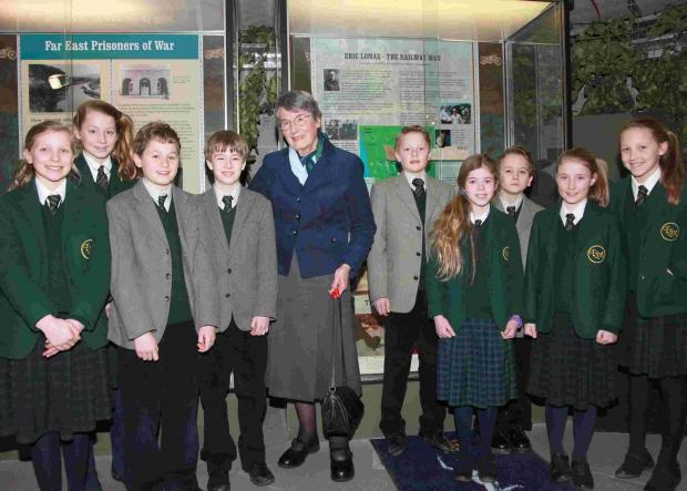 Children from Forres Sandle Manor with Patti Lomax, at the opening of a display dedicated to her husband Eric at the Royal Signals Museum in Blandford