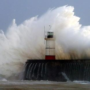 Salisbury Journal: Waves crash over the harbour wall in Newhaven, Sussex