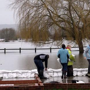 Salisbury Journal: Northmoor residents build a wall from sandbags to protect their community from the flooding on the Somerset Levels