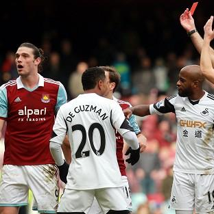 Andy Carroll, left, will serve a three-match ban