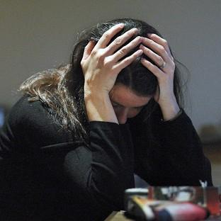 PICTURE POSED BY MODEL. File photo dated 08/11/07 of a woman with her head in her hands as women and the under-50s make up the vast majority of people needing treatment for anxiety or depression, new figures show.