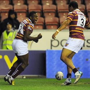 Jermaine McGillvary, left, scored a hat-trick in the win over Wigan