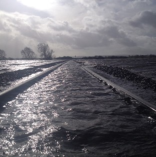 The line at Bridgwater, Somerset, was under water after the River Perrett flooded on the Somerset Levels (Network Rail)