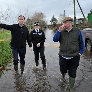 Salisbury Journal: Prime Minister David Cameron with Bridgwater and West Somerset MP Ian Liddell-Grainger (right) during a visit to Goodings Farm in Fordgate, Somerset