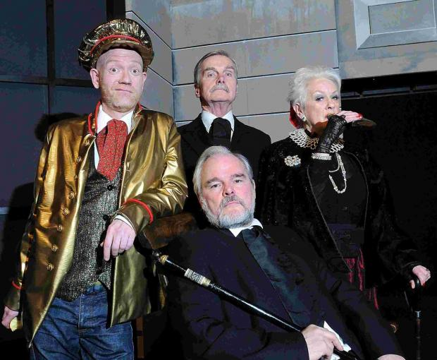 Studio Theatre's Making Money. Stew Taylor as Lipwig, Peter Mitchell as Drumknott, Anthony von Roretz as Vetinari and Theo Ross as Miss Lavish. DC4567P6