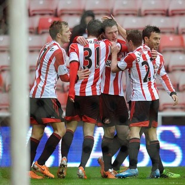 Salisbury Journal: Craig Gardner, centre, is congratulated by his Sunderland team-mates after scoring