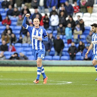 Ben Watson, left, celebrates putting Wigan back in the lead