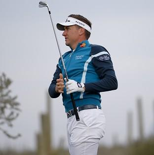 Ian Poulter, pictured, suffered a 2&1 defeat against Rickie Fowler (AP)