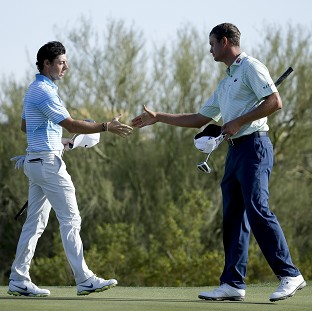 Rory McIlroy, left, was beaten by Harris English, right, in the secind round of the WGC-Accenture Match Play Championship (AP)