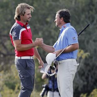 Victor Dubuisson, left, beat Graeme McDowell to reach the semi-finals (AP)