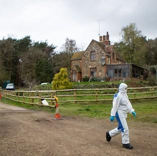 Police at the scene at Keepers Cottage Stud in Waverley Lane, Farnham, Surrey