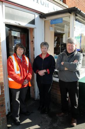 Post lady Caroline Roberts with Julie Telfter and postmaster Tony Smith after the robbery