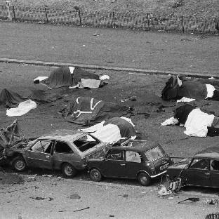 Dead horses and wrecked cars at the scene of an IRA bomb which exploded as the Hous