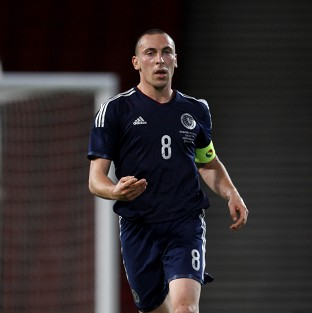 Brown strike seals Scotland win