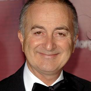 Sir Tony Robinson has collected a Blue Peter Book Award