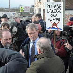 Salisbury Journal: Environment Secretary Owen Paterson (centre) visiting Northmoor Pumping Station, Somerset, in January