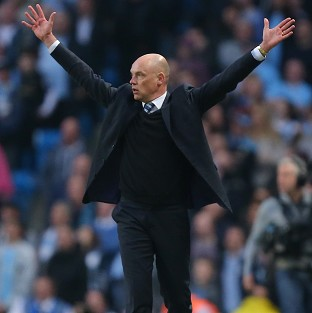 Uwe Rosler's Wigan will face Arsenal in the FA Cup semi-finals