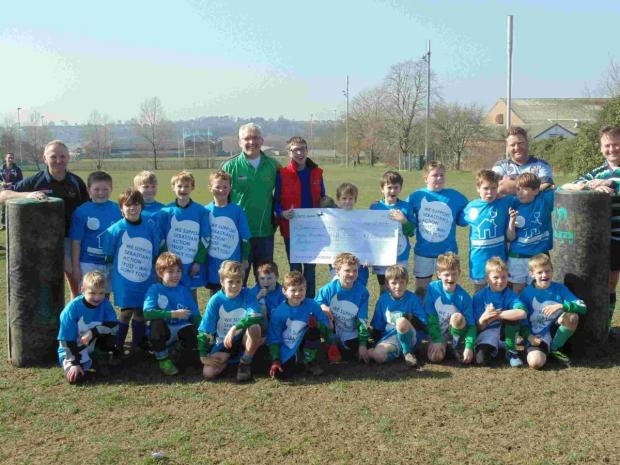 Rugby club hands over charity cheque