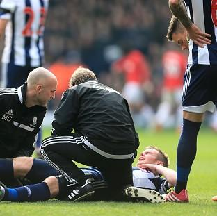 Salisbury Journal: Chris Brunt receives treatment during West Brom's match against Manchester United on Saturday