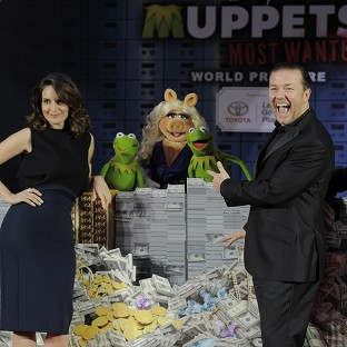 Muppets Most Wanted cast members pose together at the premiere of the film in LA