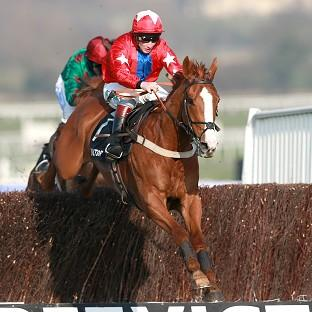 Sire de Grugy, ridden by Jamie Moore, won the BetVictor Queen Mother Champion Chase