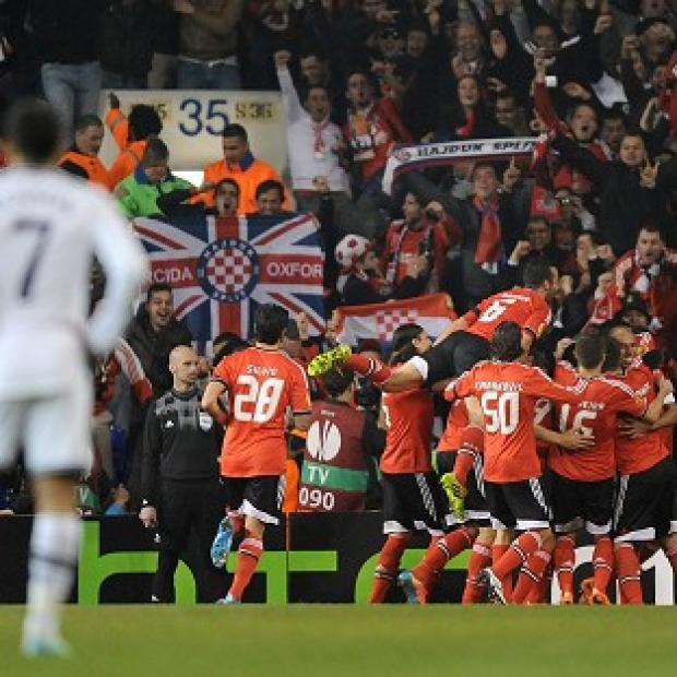 Salisbury Journal: Benfica players celebrate after Luisao scores their second goal at White Hart Lane