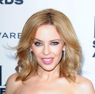 Kylie Minogue said she used to sing into her hairbrush