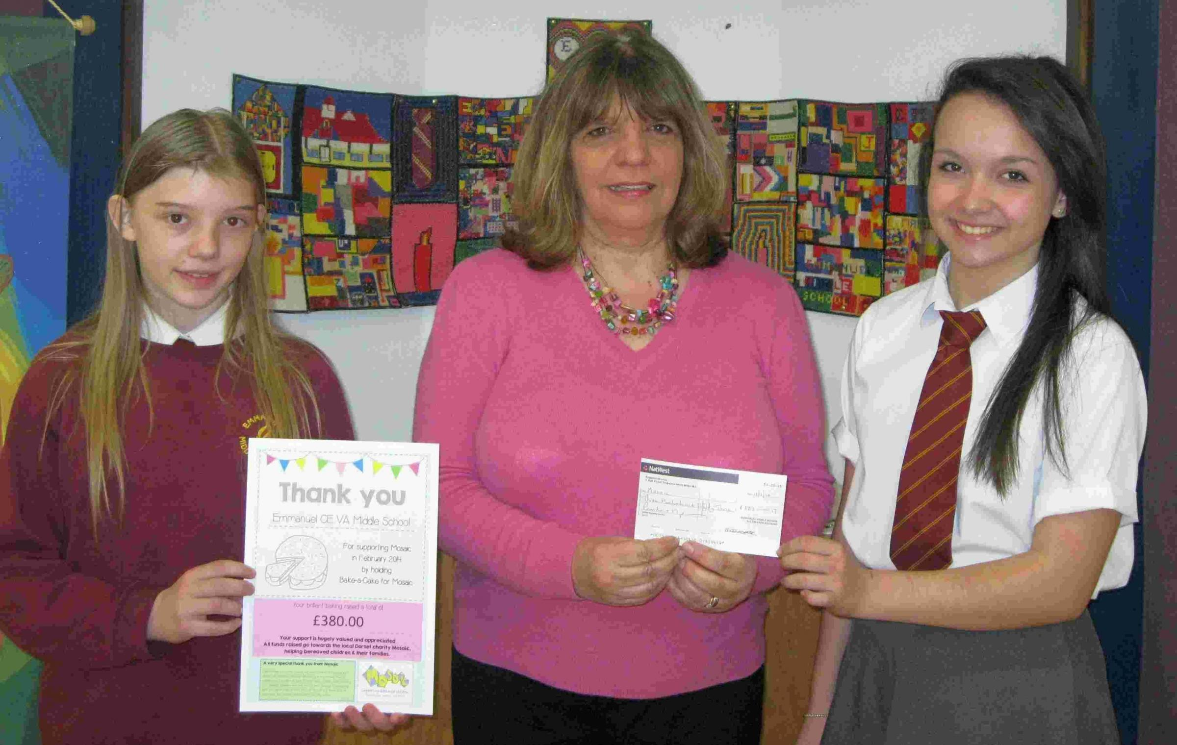 From left, Elise McNally, Margaret Hannibal and Elizabeth Wilson after a successful cake sale at Emmanuel School