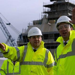 Salisbury Journal: Labour leader Ed Miliband (right) and Thomas Docherty during a visit to the Rosyth Dockyard at Dunfermline, Fife