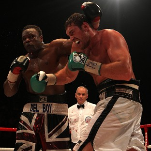 Dereck Chisora (left) and Tyson Fury (right) will meet again in Manchester this summer, three years on from their initial encounter in London