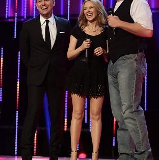 Salisbury Journal: Jason Donovan, Kylie Minogue and David Walliams on stage for BBC Sport Relief 2014 (PA/BBC)