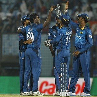 Sri Lanka's players celebrate the dismissal of Michael Swart in Chittagong (AP)