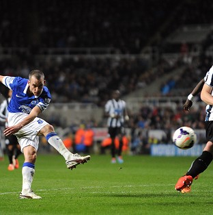 Everton's Leon Osman scores his side's third goal.