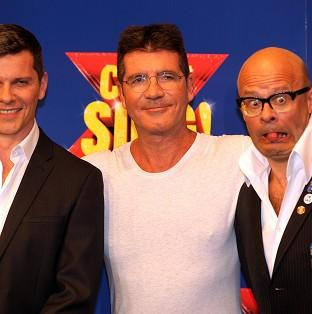Salisbury Journal: Nigel Harman (left) will play Simon Cowell (centre) in the musical penned by Harry Hill (right).