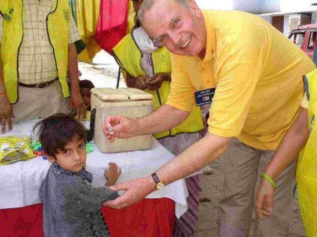 Rotarian Alan Holland helps administ