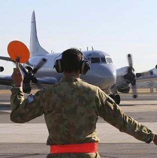 A Royal Australian Air Force AP-3C Orion returns to Perth after searching