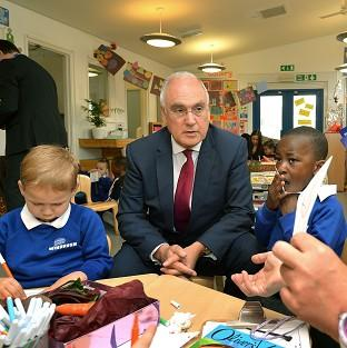 Salisbury Journal: Sir Michael Wilshaw, Ofsted chief inspector, with Rhys Lockyer, left, and King Akingbulu during his visit to the Windrush Nursery in Woolwich, prior to the Ofsted Early Years Annual Report being published